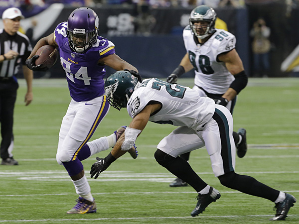 Vikings wide receiver Cordarrelle Patterson runs from Eagles strong safety Nate Allen after making a reception during the first half. (Ann Heisenfelt/AP)
