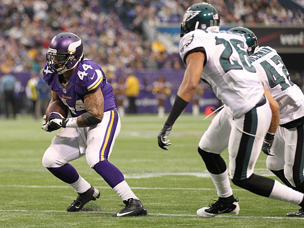 Vikings running back Matt Asiata carries the ball during the first half against the Eagles. (Andy King/AP)