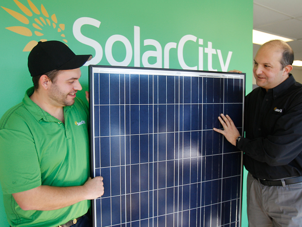 Operations manager Russell Pierson, left, and Leon Keshishian, regional vice president, are showing Chinese-made solar panels at their office in Blackwood, N.J. (AKIRA SUW/Staff Photographer)