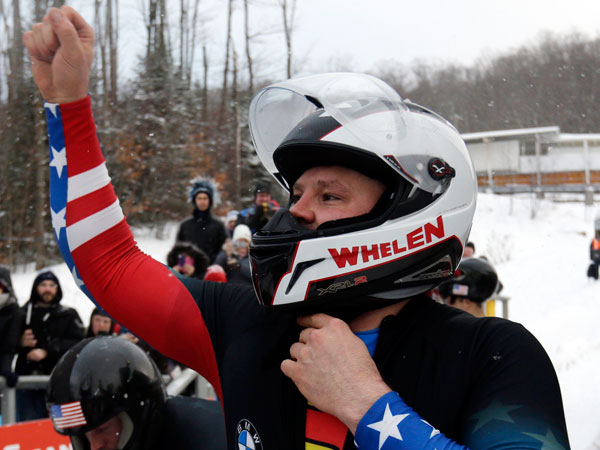 United States´ pilot Steven Holcomb celebrates his team´s win in the four-man bobsled World Cup event on Sunday, Dec. 15, 2013, in Lake Placid, N.Y. (Mike Groll/AP)