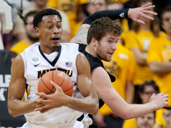 Missouri´s Johnathan Williams III, left, pulls down a rebound in front of Western Michigan´s Shayne Whittington, right, during the first half of an NCAA college basketball game Sunday, Dec. 15, 2013, in Columbia, Mo. Missouri won the game 66-60. (L.G. Patterson/AP)
