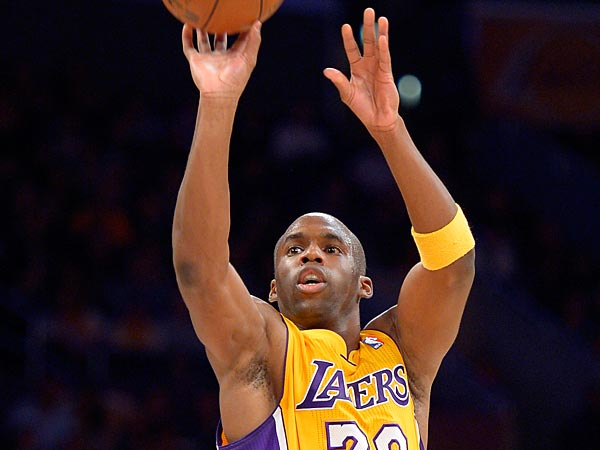 Los Angeles Lakers guard Jodie Meeks puts up a shot during the first half of their NBA basketball game against the Denver Nuggets, Friday, Nov. 30, 2012, in Los Angeles. (AP Photo/Mark J. Terrill)