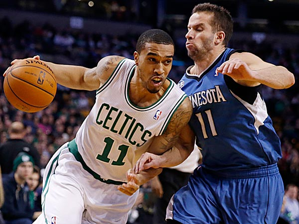 The Celtics´ Courtney Lee drives past the Timberwolves´ J.J. Barea. (Michael Dwyer/AP)