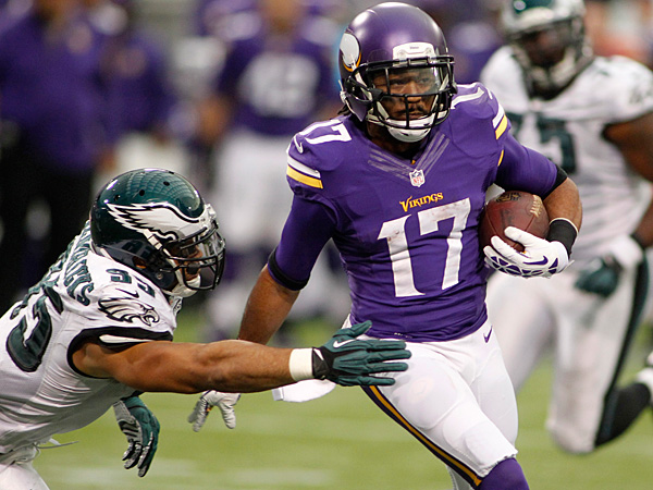 Vikings wide receiver Jarius Wright runs from Eagles linebacker Mychal Kendricks after making a reception during the second half. (Andy King/AP)