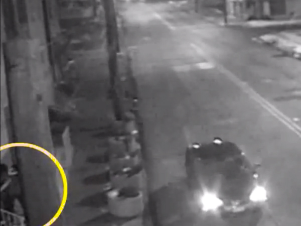 A suspect was caught on camera early Saturday stabbing a man to death in Camden as several cars drove past. None of the motorists stopped.