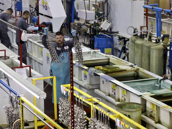 FILE - In this Thursday, Oct. 10, 2013, file photo, employees at Sheffield Platers Inc. work on the factory floor in San Diego. The government issues its second and final estimate of worker productivity and labor costs in the July-September quarter on Monday, Dec. 16, 2013. (AP Photo/Lenny Ignelzi, File)