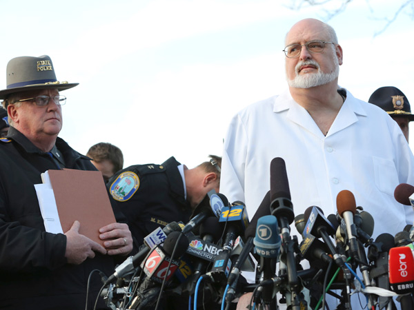 The victims of the Newtown shooting were shot multiple times by semiautomatic rifle, the medical examiner said Saturday. (AP Photo/Mary Altaffer)