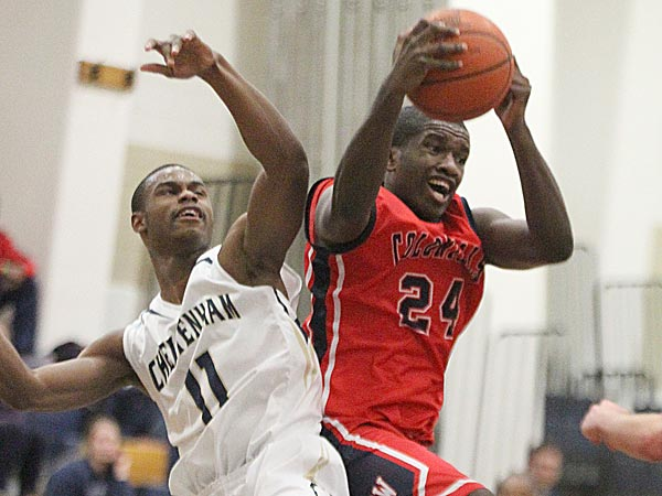 Cameron Johnson of Plymouth Whitemarsh pulls down a rebound in<br />front of Jeremiah Coleman of Cheltenham. (Charles Fox/Staff Photographer)