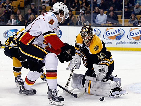 Bruins goalie Tuukka Rask protects the net against Flames center Joe Colborne. (Elise Amendola/AP)