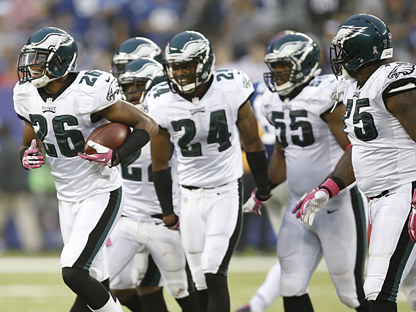 Members of the Eagles defense celebrate an interception. (Kathy Willens/AP)