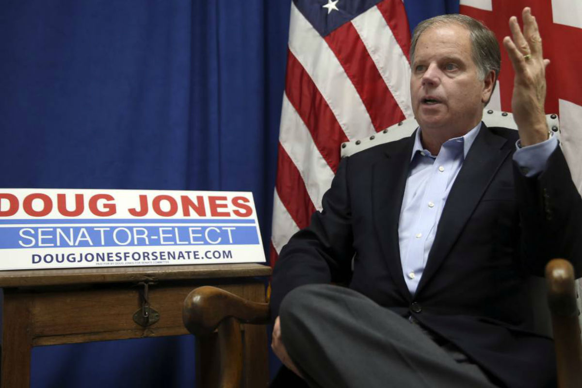 "FILE - In this Wednesday, Dec, 13, 2017 file photo, Democrat Doug Jones speaks during an interview with the Associated Press, in Birmingham, Ala. Democrat Jones, the newly elected Alabama senator-elect, insisted to both parties in politically divided Washington Sunday, Dec. 17 that he´ll leave ""all the options on the table"" when it comes to his votes next year on issues from immigration to infrastructure."