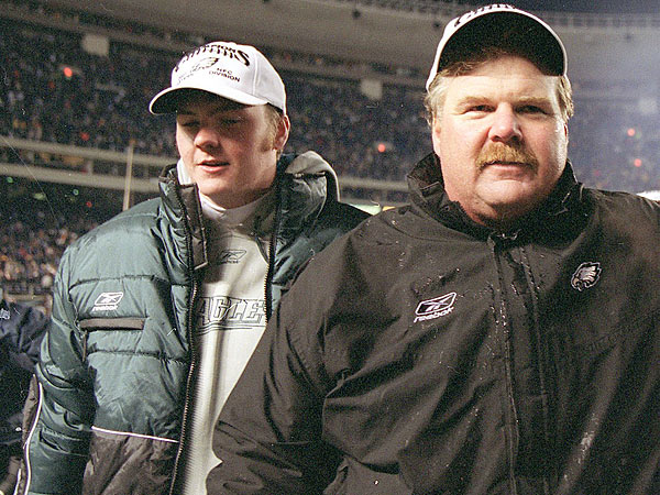 Andy Reid and Garrett Reid after a 2001 Eagles-Giants game. (Yong Kim/Staff file photo)