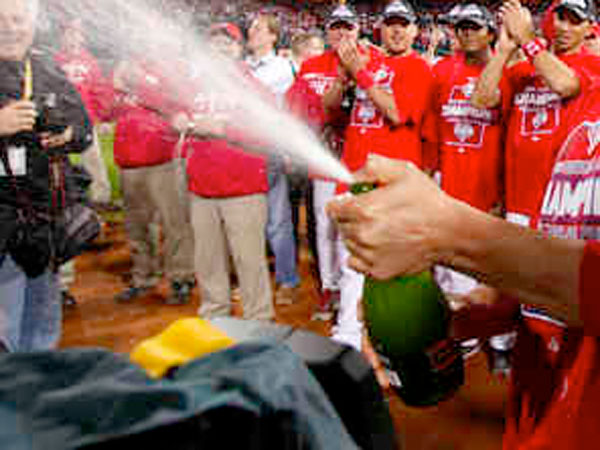 The Phillies pop champagne at Citizens Bank Park. (YONG KIM / Staff Photographer)