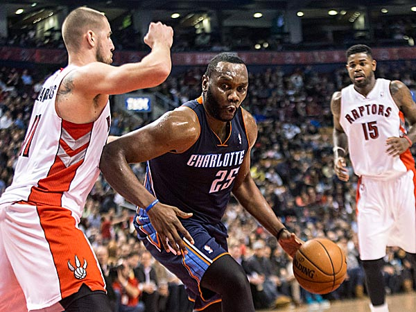 The Bobcats´ Al Jefferson drives on the Raptors´ Jonas Valanciunas. (Chris Young/The Canadian Press/AP)