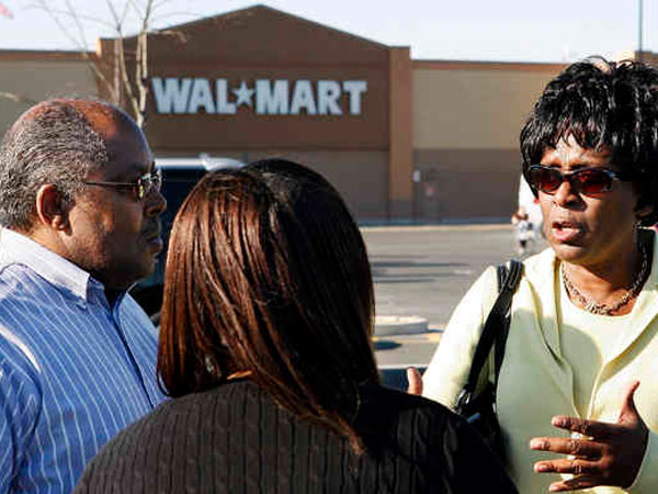 Ronald Tinsley , Shelia Ellington (center), and Tracy Jenkins were at the store when a racist remark was made. (Mel Evans / Associated Press, File)