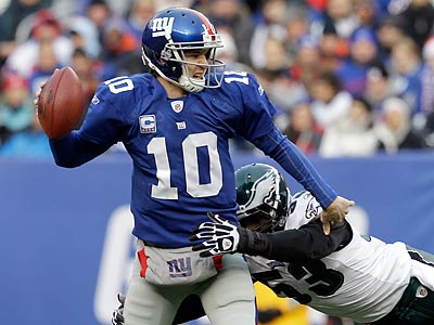 Giants QB Eli Manning threw 25 interceptions last season. (Kathy Willens/AP)