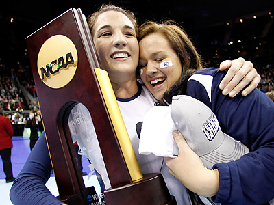 Blair Brown and Erica Denney celebrate after beating Cal to win the NCAA Division I Volleyball Championship. (AP Photo/Charlie Riedel)