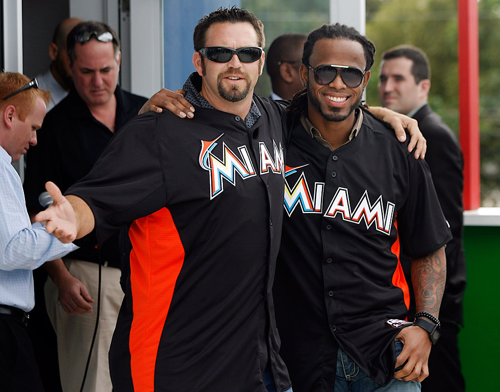 Newly acquired Miami Marlins´ Jose Reyes right, and Heath Bell pose for the cameras. (AP Photo/Jeffrey M. Boan)