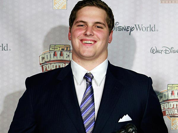 Texas A&M´s Luke Joeckel displays the Outland Trophy Award after being named the nation´s outstanding interior lineman at the Home Depot College Football Awards in Lake Buena Vista, Fla., Thursday, Dec. 6, 2012. (AP Photo/John Raoux)