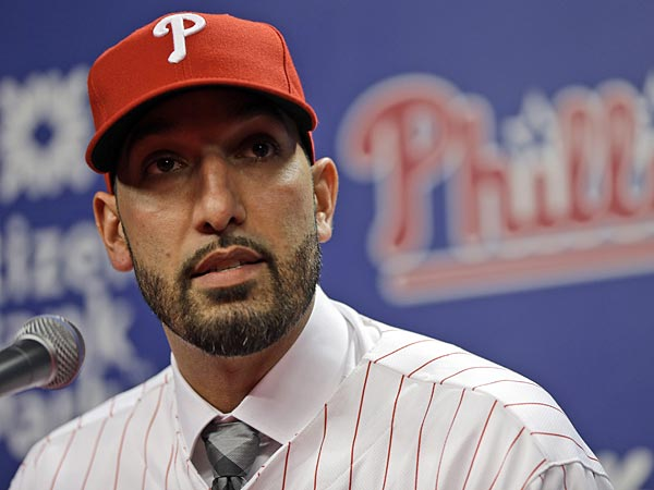 New Philadelphia Phillies relief pitcher Mike Adams speaks during an<br />introductory news conference Thursday, Dec. 20, 2012, in Philadelphia.<br />The Phillies agreed to a two-year contract with reliever Adams.  (AP<br />Photo/Matt Rourke)
