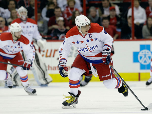 The Capitals´ Alex Ovechkin (8) skates against the Carolina Hurricanes during the first period of an NHL hockey game in Raleigh, N.C., Friday, Dec. 20, 2013. (Gerry Broome/AP)