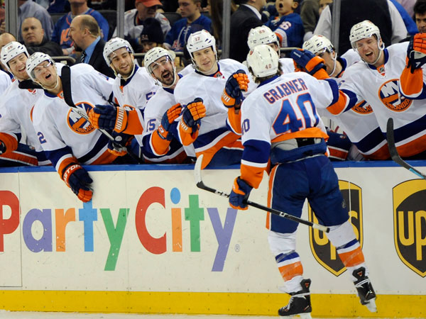 The Islanders´ Michael Grabner (40) is congratulated by teammates after he scored a goal against the New York Rangers in the first period of an NHL hockey game on Friday, Dec. 20, 2013, in New York. Grabner scored two goals during the Islanders 5-3 win. (Kathy Kmonicek/AP)