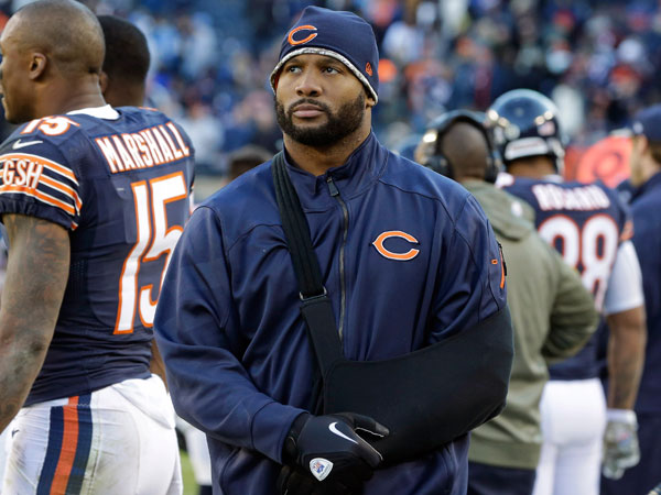 Bears linebacker Lance Briggs walks on the sidelines during an NFL football game against the Detroit Lions in Chicago. Briggs, sidelined the past two months by a shoulder injury, hopes to receive medical clearance to play against the Philadelphia Eagles on Sunday, Dec. 22, 2013. (Nam Y. Huh/AP)
