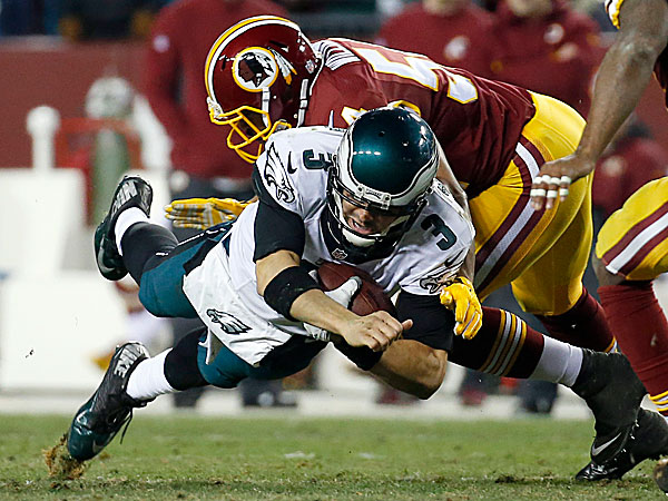 Eagles quarterback Mark Sanchez is stopped by Redskins outside linebacker Trevardo Williams during the second half. (Alex Brandon/AP)