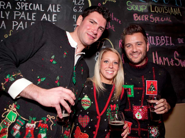 "Gene Willard, Lindy Smith and Doug Smith at The Leukemia and Lymphoma Society´s ""Cancer is Ugly"" Sweater Christmas Party at Yards Brewing Company on Dec. 20, 2012. ( Hillary Petrozziello / Philly.com )"