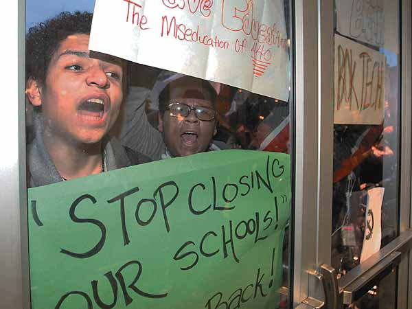 About 100 students, parents, and organizers found themselves temporarily locked out of the School District of Philadelphia Building after marching from City Hall. They were eventually allowed to come in.  Students, like Joshua Garcia, Jr., left, of Charles Carroll High School, wanted to tell the School Reform Commission exactly what they think about Superintendent Bill Hite´s plan to close 37 schools and close or change programs at dozens others.    ( Charles Fox / Staff Photographer )