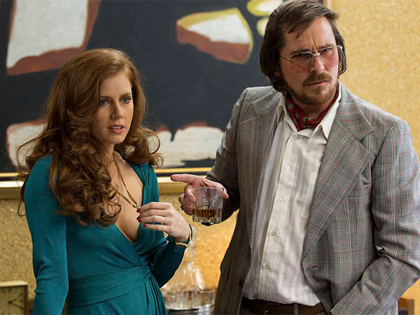 "Amy Adams and Christian Bale in a scene from Columbia Pictures´ ""American Hustle,"" based on the Abscam scandal of the 1970s and also starring Jennifer Lawrence and Bradley Cooper."