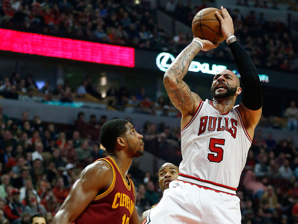 Bulls forward Carlos Boozer (5) shoots over Cleveland Cavaliers forward Tristan Thompson (13) during the second half of an NBA basketball game on Saturday, Dec. 21, 2013, in Chicago. The Bulls won 100-84 ending a four-game losing streak. Boozer hit 8 of 14 shots. (Andrew A. Nelles/AP)