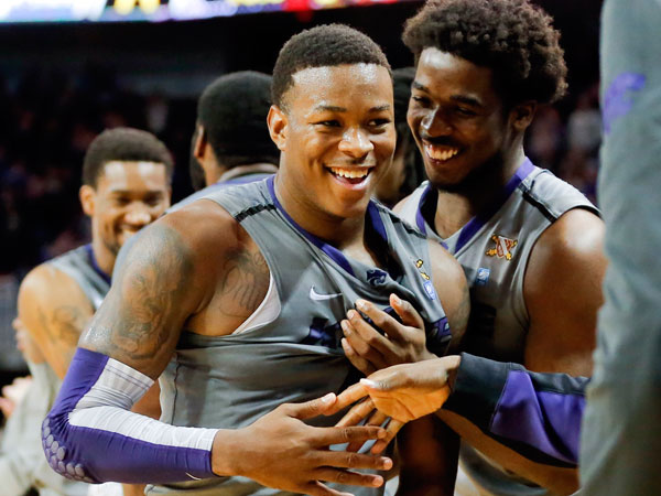 Kansas State´s Marcus Foster is congratulated by teammates after an NCAA college basketball game against Gonzaga in Wichita, Kan., on Saturday, Dec. 21, 2013. (AP Photo/The Wichita Eagle, Travis Heying)