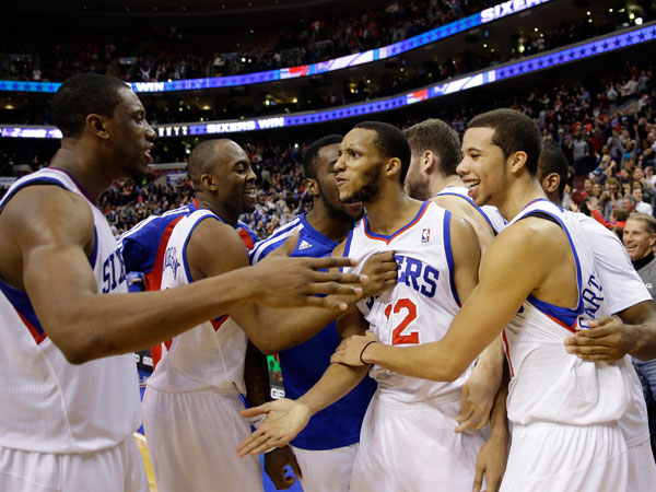 The Sixers huddle (Matt Slocum/AP)