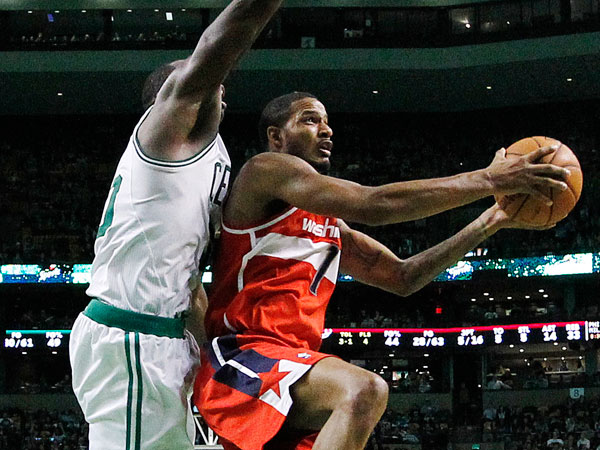 The Wizards´ Trevor Ariza (1) shoots against Boston Celtics´ Brandon Bass (30) in the third quarter of an NBA basketball game in Boston, Saturday, Dec. 21, 2013. The Wizards won 106-99. (Michael Dwyer/AP)
