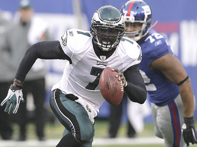 Michael Vick accounted for 246 total yards and three touchdowns in the fourth quarter Sunday. (Yong Kim/Staff Photographer)