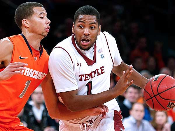 Temple´s Khalif Wyatt (right) drives against Syracuse´s Michael Carter-Williams during the first half. (Jason DeCrow/AP)
