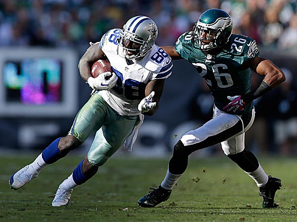 Cowboys wide receiver Dez Bryant runs with the ball as Eagles cornerback Cary Williams defends. (Matt Rourke/AP)