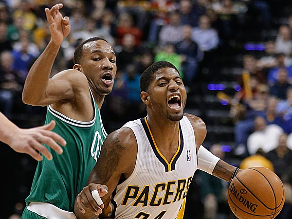 The Pacers´ Paul George goes to the basket past the Celtics´ Jeff Green. (Darron Cummings/AP)