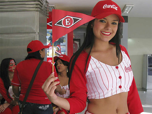 A cheerleader for Leones del Escogido. No one can quite say why the country is such a baseball factory.