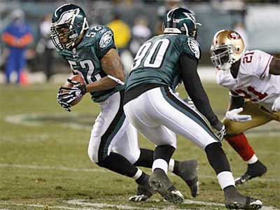 Eagles linebacker Tracy White (52) had an interception Sunday against the 49ers.