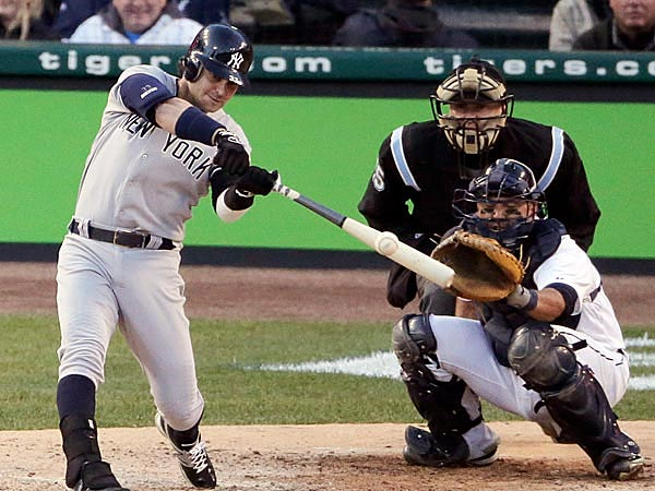 New York Yankees´ Nick Swisher hits a RBI double in the sixth inning during Game 4 of the American League championship series against the Detroit Tigers Thursday, Oct. 18, 2012, in Detroit. (AP Photo/Charlie Riedel)