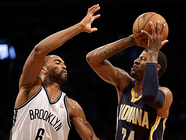 The Pacers´ Paul George shoots over the Nets´ Alan Anderson. (Seth Wenig/AP)