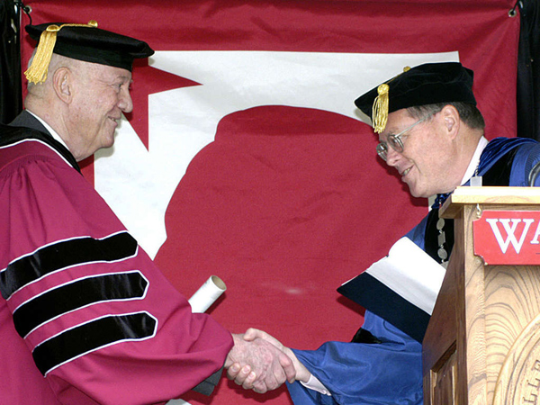John Eisenhower (left), a president´s son who built a career in letters, gets an honorary degree in 2005 at Washington College in Maryland. (AP)