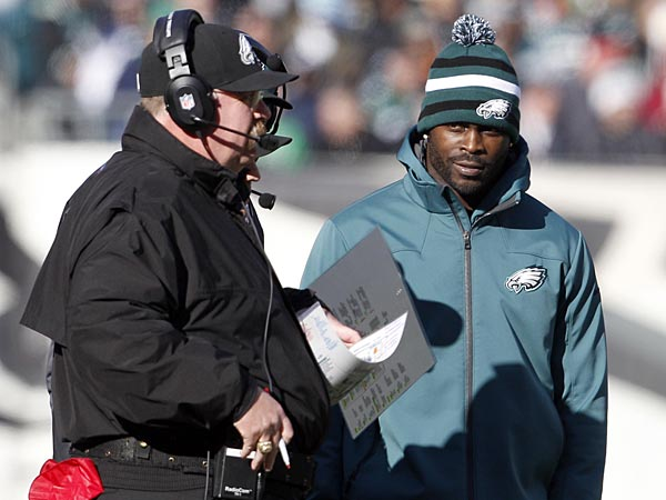Eagles quarterback Michael Vick stands next to Head Coach Andy Reid against the Washington Redskins on Sunday, December 23, 2012. (Yong Kim/Staff Photographer)