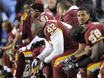 Redskins defensive tackle Albert Haynesworth sits on the bench during Monday´s 45-12  loss to the Giants. (AP Photo/Nick Wass)