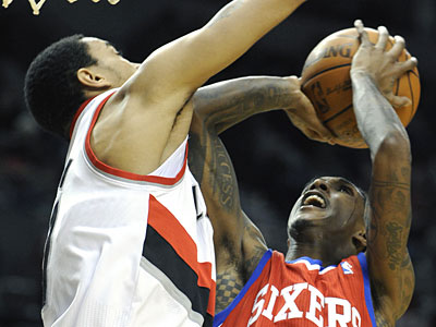 Lou Williams, right, led the Sixers offense with 25 points. (Greg Wahl-Stephens/AP Photo)