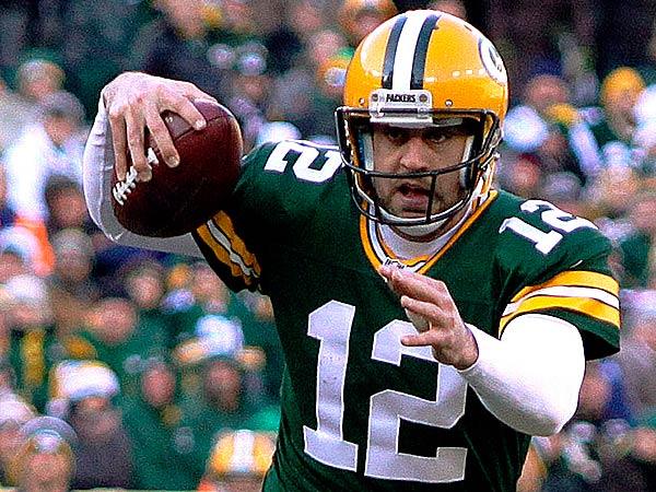 Green Bay Packers quarterback Aaron Rodgers scrambles. (Cory Dellenbach/AP)