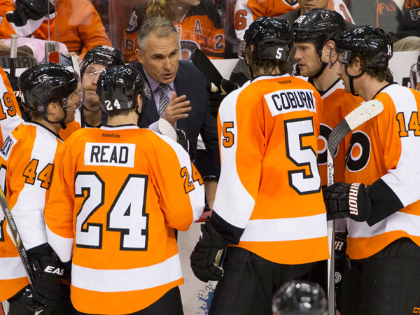 Craig Berube talks things over with his team during the third period of an NHL hockey game against the Winnipeg Jets, Friday, Nov. 29, 2013, in Philadelphia. The Flyers win 2-1. (Chris Szagola/AP file)