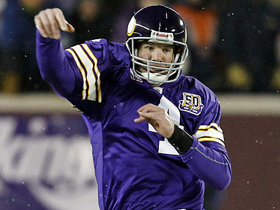 The Eagles are reportedly looking at Brett Favre to serve as backup quarterback to Michael Vick. (Ann Heisenfelt/AP)